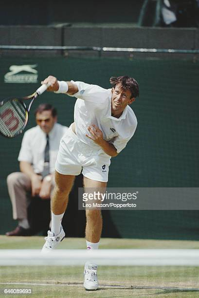 English tennis player Jeremy Bates pictured in action competing to reach the fourth round in the Men's Singles tournament at the Wimbledon Lawn...