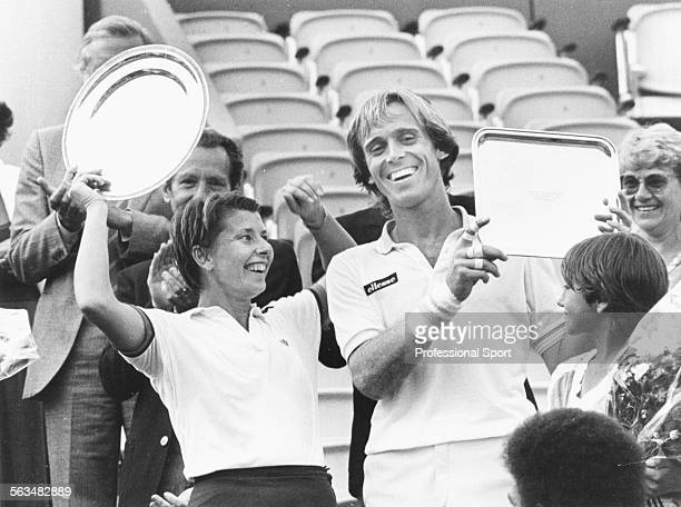 English tennis player John Lloyd and Australian tennis player Wendy Turnbull pictured together smiling as they hold their trophies after winning the...