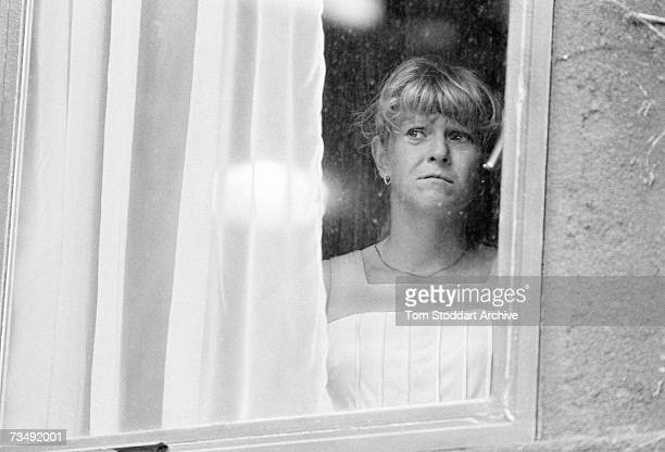 English tennis player Sue Barker looking out of a centre court window after her final appearance at the Wimbledon tennis tournament June 1984