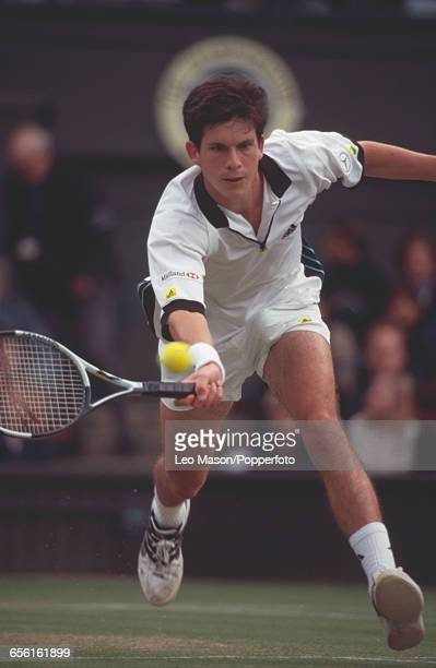 English tennis player Tim Henman pictured in action during competition to reach the semifinals of the Men's Singles tournament at the Wimbledon Lawn...