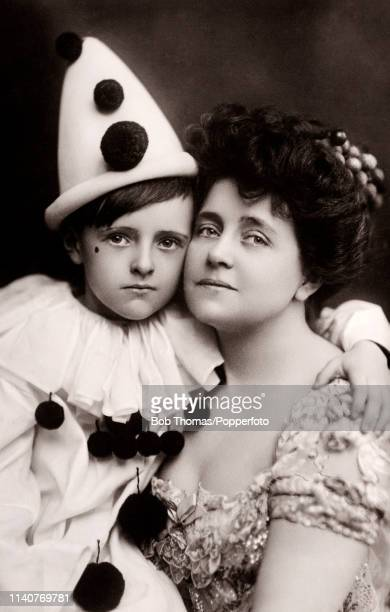 English theatre and film actress Eva Moore whose careeer spanned six decades with her son Jack dressed as a pierrot or clown circa 1912 Moore was...