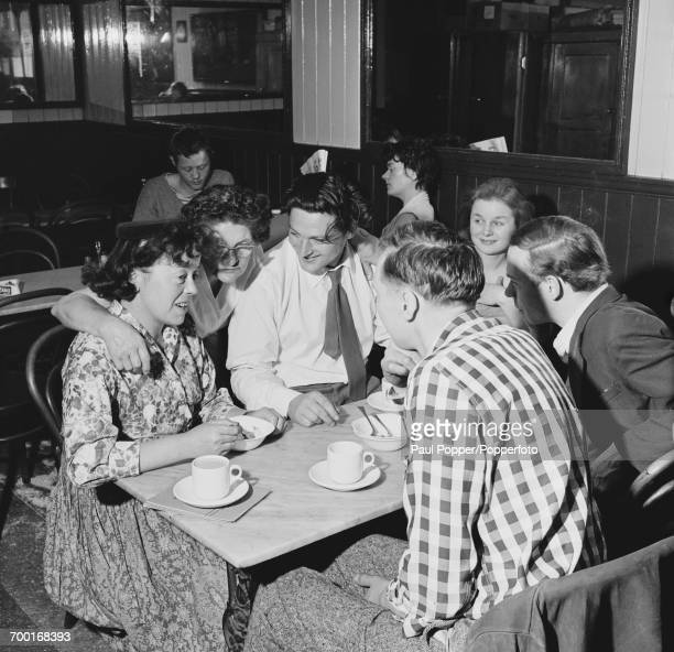 English theatre director Joan Littlewood theatre manager Gerry Raffles and actors from Theatre Workshop in a cafe in Stratford London 13th June 1959...