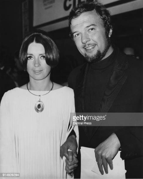 English theatre director Peter Hall arrives at the Carlton Theatre, Haymarket, London, with his wife Jacqueline, to attend the Gala World Premiere of...