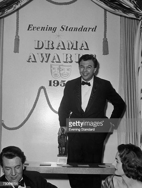 English theatre director Peter Hall attends the Evening Standard Drama Awards for 1958 to collect a Best Play of the Year award on behalf of...