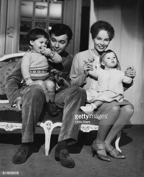 English theatre director Peter Hall , director of the Shakespeare Memorial Theatre in Stratford-Upon-Avon, with his wife, actress Leslie Caron, their...