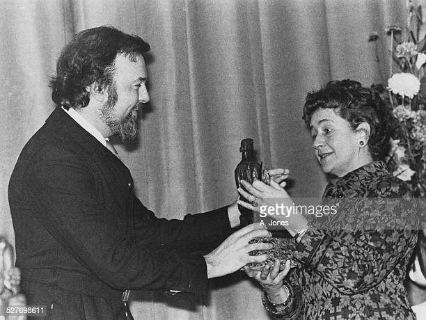 English theatre director Peter Hall presents the 1971 Evening Standard theatre award for Best Actress to Dame Peggy Ashcroft 18th January 1972...