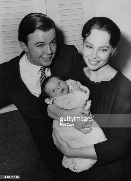 English theatre director Peter Hall with his wife actress Leslie Caron and their twoweekold baby son Christopher at their home in London 10th April...