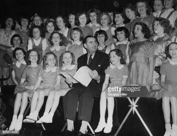 English theatre impresario Emile Littler holds an audition of child actors for the London Casino pantomime 'Aladdin' 30th October 1951