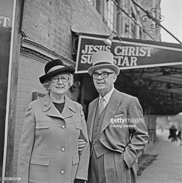 English theatre impresario Sir Emile Littler and his wife Lady Littler. British actress Cora Goffin , outside a theatre showing the rock musical...