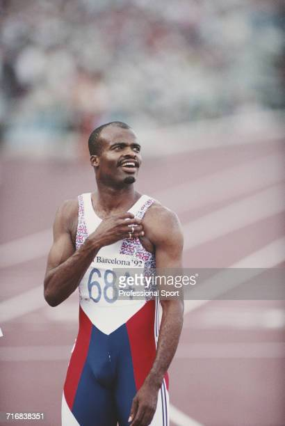 English track and field athlete Kriss Akabusi of the Great Britain team celebrates after finishing in third place to win the bronze medal in the...