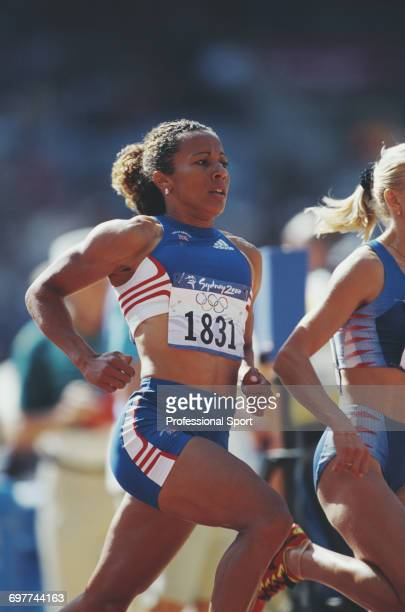 English track athlete Kelly Holmes pictured in action for the Great Britain team to compete to cross the finish line in third place to win the bronze...