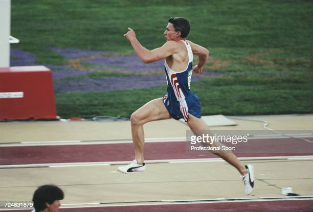 English triple jumper Jonathan Edwards competes for the Great Britain team to finish in 2nd place to win the silver medal in the Men's triple jump...