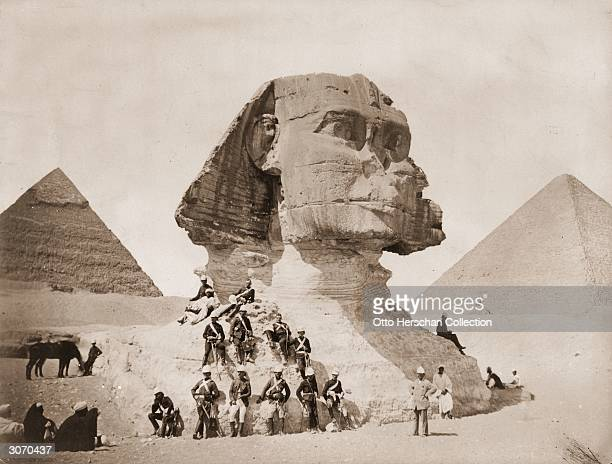 English troops take time out after the bombardment of Alexandria to visit the pyramids and the Sphinx