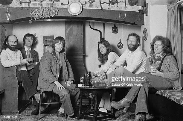 English violinist and folk musician Dave Swarbrick in a pub with members of his band 1976 Left to right Dan Ar Braz Dave Pegg Swarbrick Savourna...