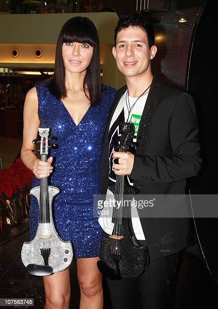 English violinist Linzi Stoppard and singer Ben Lee pose during a preview press conference at New Town Plaza on December 13 2010 in Hong Kong China