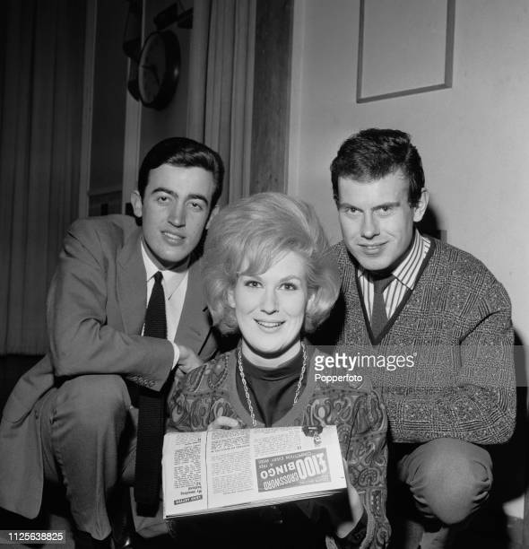 English vocal trio The Springfields comprising from left Mike Hurst Dusty Springfield and Tom Springfield pictured together at a venue in England in...