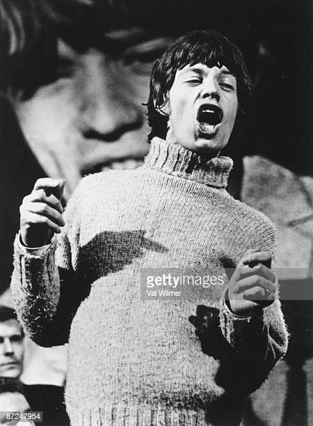 English vocalist Mick Jagger of the Rolling Stones appears on television music show 'Ready Steady Go' circa 1965