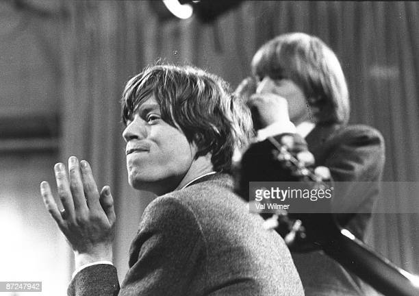 English vocalist Mick Jagger of the Rolling Stones performs live on stage on the TV show 'Ready Steady Go' in 1964 Behind him is Stones guitarist...