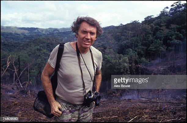 English war photographer Don McCullin with his favourite Olympus camera in the Philippines 7th November 1986