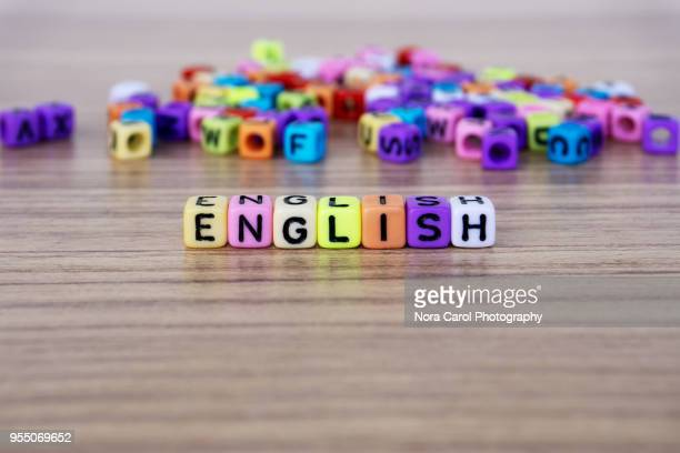 english word and alphabet letter beads - england stock-fotos und bilder