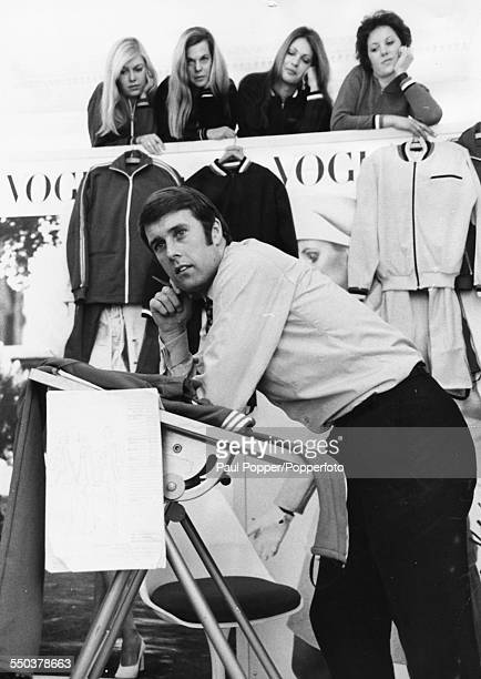 English World Cup winning football player, Geoff Hurst posing with a group of models and samples of the tracksuit he designed for Unique Sports Wear,...