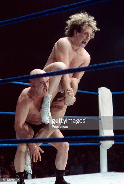English wrestler Jackie Pallo is raised in the air on the shoulder of an opponent in the ring during a bout in 1966