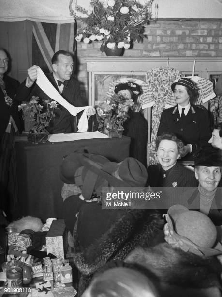 English writer actor and director Noël Coward auctions a pair of stockings worn by Queen Victoria at Marylebone London 11th June 1941 The stockings...