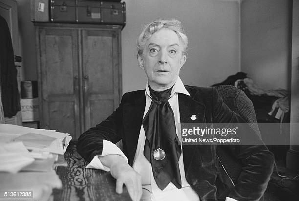 English writer and actor Quentin Crisp posed sitting at a table in London on 5th June 1981.