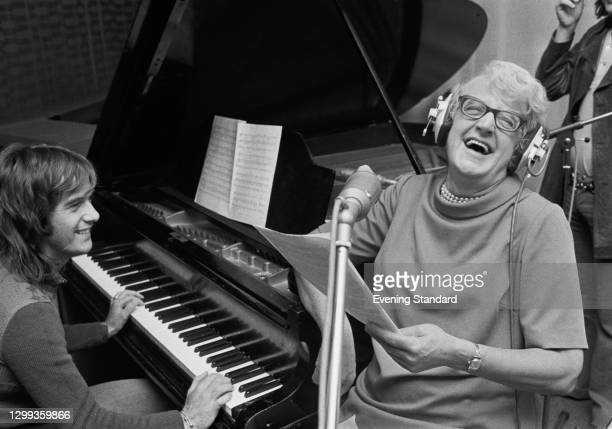 English writer and television personality Margaret Powell performs with a piano accompaniment, UK, 10th October 1972. She was known for her book...