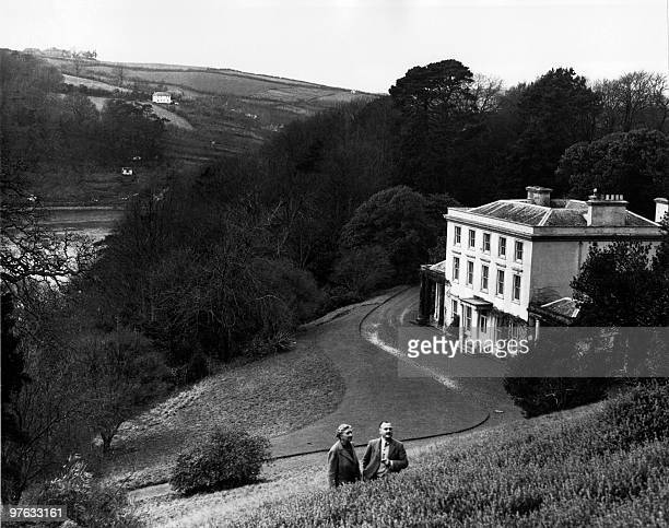 English writer Dame Agatha Christie and her husband Max E L Mallowan pose in March 1946 in the ground of their home Greenway House in Devonshire...