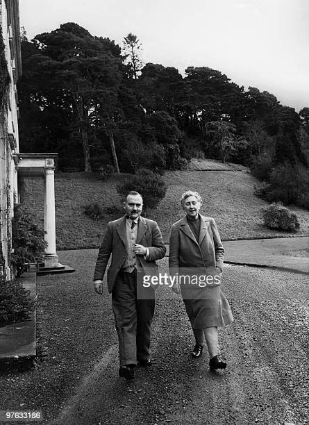 English writer Dame Agatha Christie and her husband Max E L Mallowan walk in March 1946 in the ground of their home Greenway House in Devonshire...