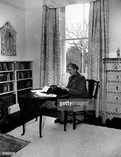 English writer Dame Agatha Christie at work on a typewriter in March 1946 in her home Greenway House in Devonshire Agatha Christie born Miller in...