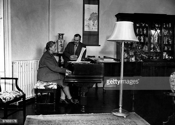 English writer Dame Agatha Christie plays the piano for her husband Max E L Mallowan in March 1946 in their home Greenway House in Devonshire Agatha...