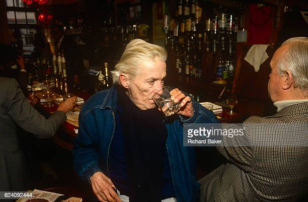 English writer Jeffrey Barnard drinks at lunchtime in his favoured Coach And Horses pub in the summer of 1990 in Soho London England Jeffrey Bernard...