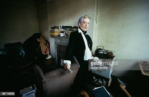 English writer Quentin Crisp at his home, 129 Beaufort Street, London, 1980. A year later, he emigrated to the United States.