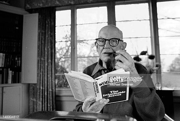 English writer Sir Pelham Grenville Wodehouse KBE aka P G Wodehouse with a copy of his book 'The Inimitable Jeeves' in Remsenburg New York State 14th...
