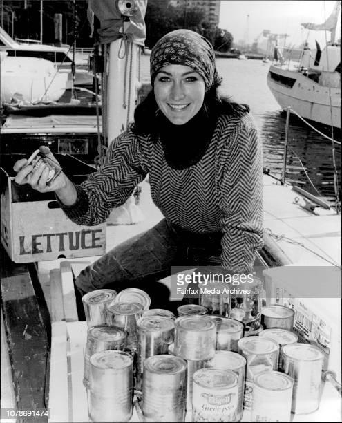 English yachtswoman Hilda Clarke who has lived in Paddington for three years carries provisions aboard the 35' Sydney/Hobart racing sloop Kurura at...