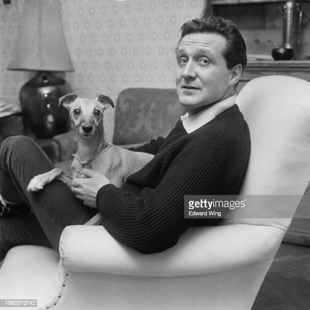 English-American actor Patrick Macnee with a whippet, UK, 27th January 1963.