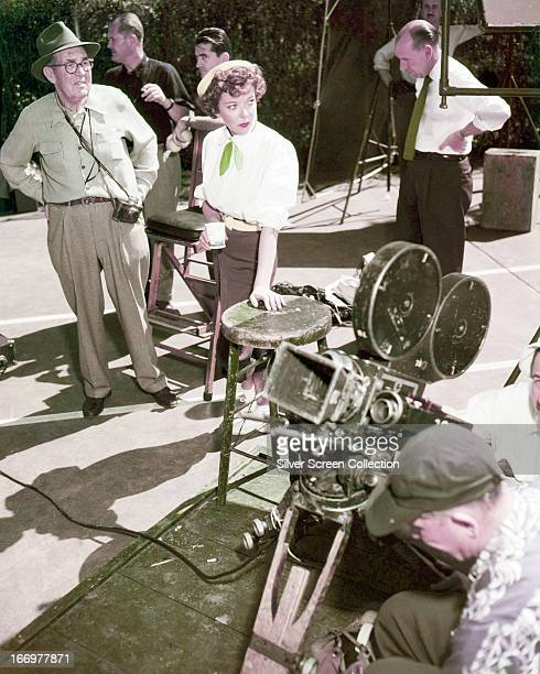 EnglishAmerican actress and director Ida Lupino with a film crew on a set circa 1945