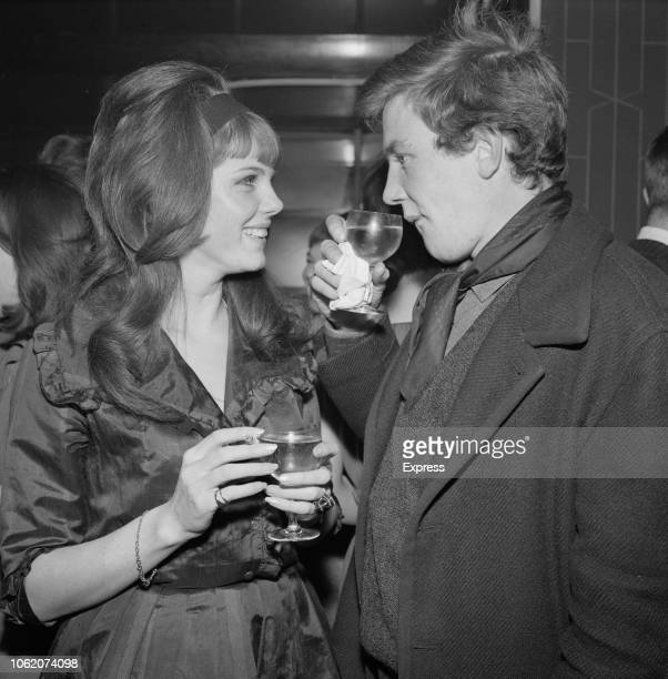 EnglishAmerican actress Samantha Eggar and English actor Albert Finney having a drink at a party celebrating the Chinese New Year UK 24th January 1963