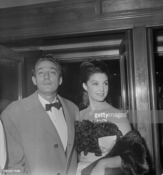 EnglishAustralian actor Peter Finch with his wife British actress and writer Yolande Turner at the premiere of 'Nine Hours to Rama' UK 21st February...