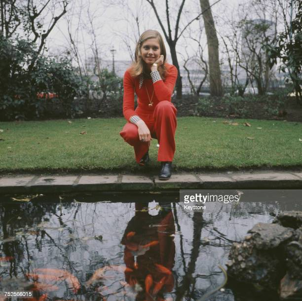EnglishAustralian singer Olivia NewtonJohn by a goldfish pond outside the Savoy Hotel in London circa 1970