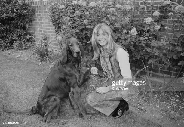EnglishAustralian singer Olivia NewtonJohn with her dog Geordie at her home in Hadley Common Hertforshire June 1970 She is about to join the group...