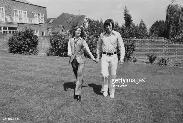 EnglishAustralian singer Olivia NewtonJohn with her fiance guitarist Bruce Welch of The Shadows at their home in Hadley Common Hertforshire June 1970...