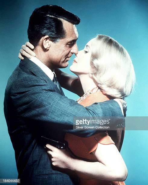 Englishborn actor Cary Grant and American actress Eva Marie Saint embracing in a promotional portrait for 'North By Northwest' directed by Alfred...