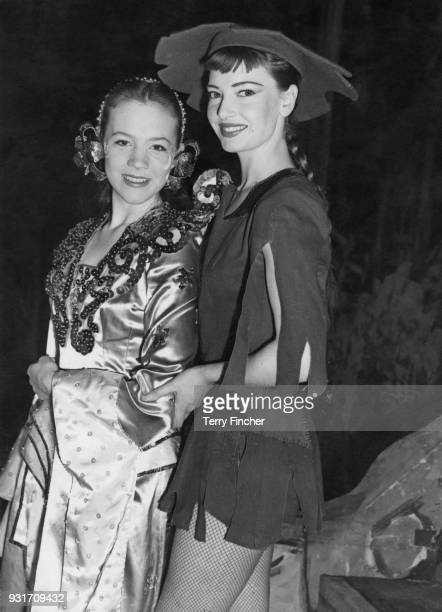 Englishborn actress singer and dancer Jeannie Carson as Aladdin and Julie Andrews as the Princess during dress rehearsals for the Christmas pantomime...