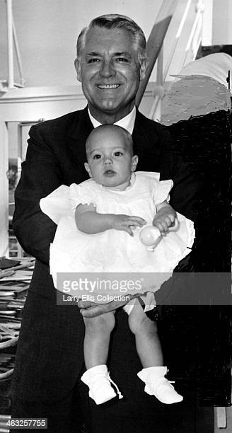 Englishborn American actor Cary Grant with his baby daughter Jennifer Grant 1966