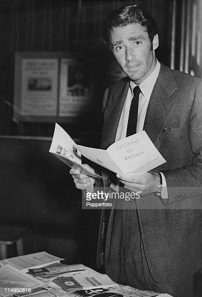 Englishborn American actor Peter Lawford holding publicity leaflets for the Festival of Britain on his arrival in Southampton from the US 28th August...