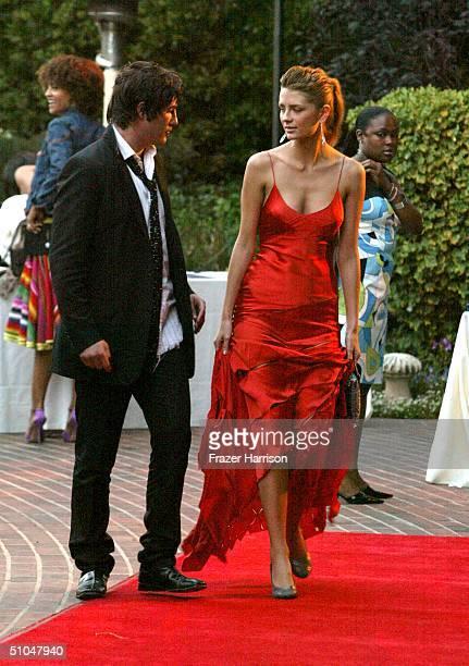 English-born American actress Mischa Barton and boyfriend Brandon Davis arrives at The 6th annual Mercedes-Benz Designcure fashion show presented by...