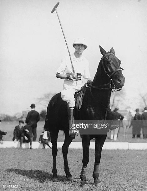 Englishborn ballroom dancing legend Vernon Castle sits atop a polo pony in full polo regalia including boots jodhpurs mallet and helmet early 1910s